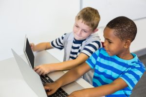 Boys learning at computer, Monsarratt Specialist Teaching Services, children support, teaching support, assessment, training,